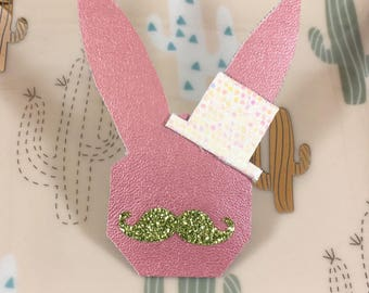 Iridescent pink pin head rabbit in hat and mustache