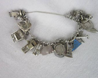 1960's Sterling Silver Charm Bracelet with 23 Sterling Charms Magnificent