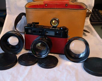 Customised Yashica Electro 35 GTN 35mm rangefinder camera kit with extra lenses, viewfinder, and bag. Very good condition with new leather.