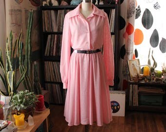 long pink 1960s shirtwaist dress . full circle skirt dress with long sleeves, slightly sheer . womens tall, medium large