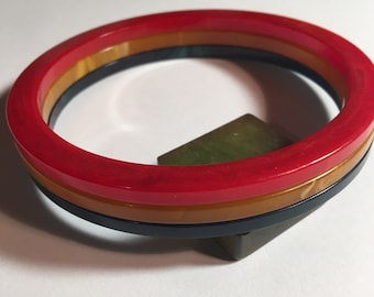 Three Vintage Marbled Bakelite Spacer Bangles  Red Blue Yellow