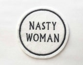 Nasty woman embroidered felt patch applique in white felt with black embroidery thread