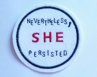 Nevertheless SHE persisted embroidered iron on patch applique in white felt with black and red embroidery thread