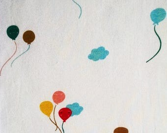 Fabric organic cotton balloons kites and clouds cute baby fabric off white background