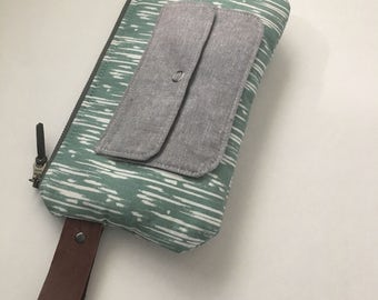 Wristlet with front pocket and leather strap