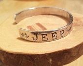 Jeep grille OIIIIIIIO hand stamped and polished aluminum cuff bracelet Typewriter font