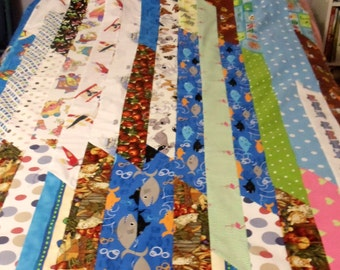 handmade, patchwork, quilt top for a child, bright colors, 40 by 60 inches, upcycled, eco friendly, ready to finish, cotton fabrics,