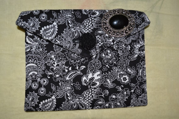 One of a kind corded pocket with button and brooch