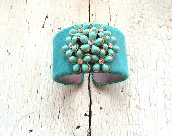 Turquoise Ultrasuede Adjustable Cuff with Rhinestone Centered Flowers