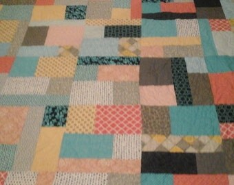 Queen size quilt in turquoise, orange and blue