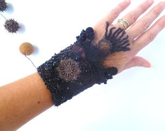Gypsy tales VII cuff, fiber art gypsy bohemian cuff, hand stitched, fiber collage, tassels, Coachella, brown and black statement cuff
