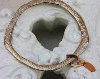 Stjern Brushed Brass Bangle. Stjern Logo Tag Charm. Stjern Design Jewelry. Gift for her