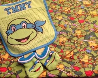 Ninja Turtle swaddling blanket,bib and booties.