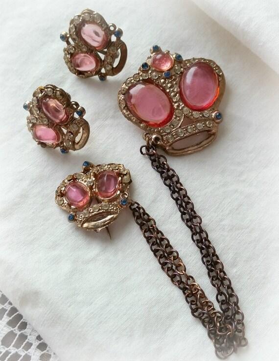 crown pin and earrings