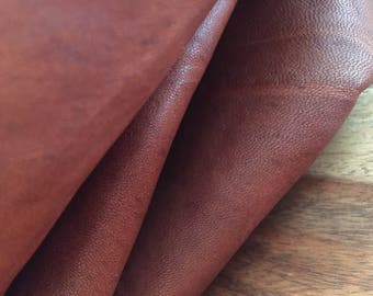 A lovely natural and mat slightly distressed  lambskin leather in cognac-  a full 4 square foot hide