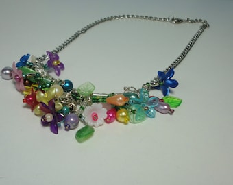 Hand Made Silver tone Metal with Mutlti- colored Variety of Lucite Flowers Necklace.