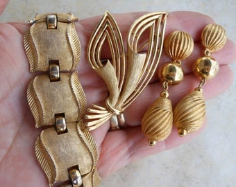 Crown Trifari bracelet brooch earrings gold jewelry set designer brand signed collection