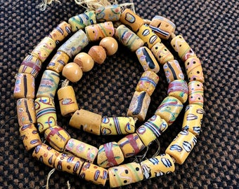 Mixed Cylinder Shaped AfricanTrade Beads, 24 inch Strand, 45 pieces.