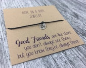 You're a Star. Tiny Sterling Silver Hand Stamped Star Bracelet on Cord. Star Bracelet. Friendship bracelet. Gift for a friend. Star jewelry.