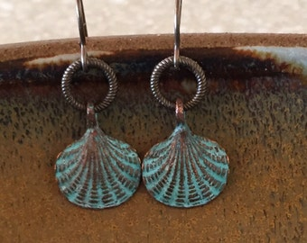 Seashell earrings with a green patina