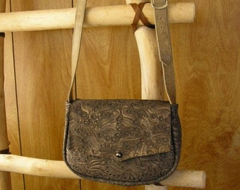 "Suede leather crossbody purse, bronze embossed 9"" x 6"" x 2"", adjustable strap 44"" to 49"", ball button , one front pocket & one inside pocket"