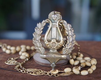 Antique Assemblage Necklace with Neoclassical Lyre Element Lions Head Antique Chain and Rosary Beads