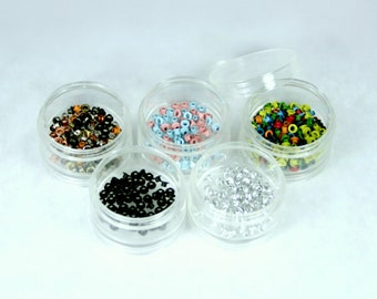 Destash collection of eyelets with clear stacking containers and lid...large variety of colors...scrapbooking and card making embellishments