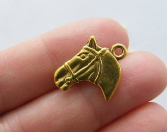 8 Horse charms antique gold tone GC106