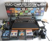 1970's Boxed Atari CX-2600 6 Switch Woody with Cords, Controllers, a Star Raiders Touch Pad and 12 Games