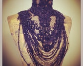 Black beaded victorian lace collar with ornate beading and fringing.