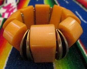 Gorgeous Art Deco Bakelite Bracelet in a deep butterscotch with decorative metal separators VLV rockabilly pinup girl  Bakelite jewelry