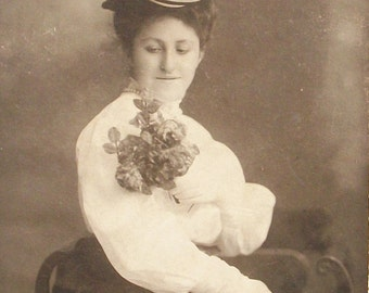 Photograph Lady Admiring Her Rose Bouquet