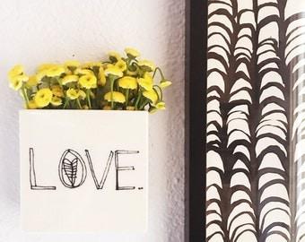 small porcelain planter / wall vase screenprinted black text LOVE.