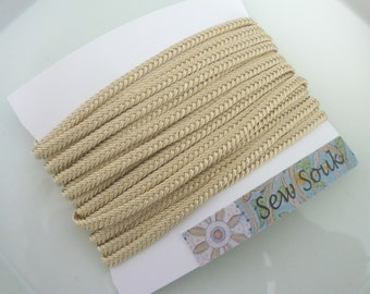 Moroccan very narrow woven flat braid, vanilla art silk,  5 metres
