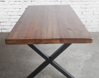 Rustic wood dining table made with reclaimed wood and steel X frame legs in choice of sizes or finishes