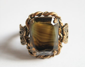 Vintage Celtic style ring.  Green brown glass ring.  Adjustable ring.