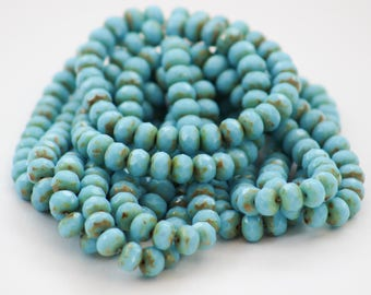 Pale turquoise blue picasso Czech glass rondelles 9x6mm - sold in packs of 10