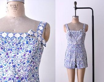 1950 floral bathing suit. L. 50's purple print swimsuit. blue white. bow. m.