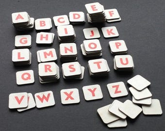 Play with words... Vintage cardboard paper letter set. Old alphabet tile game pieces. Supply for collage and lettering.