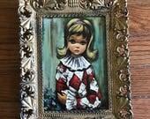 Small framed vintage jester harlequin painting