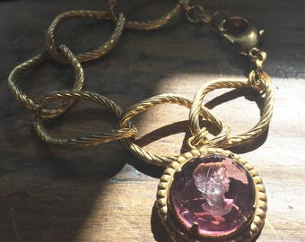 Glass intaglio cameo bracelet with vintage lady