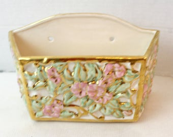 ceramic wall pocket, floral design and gold accent 1950's