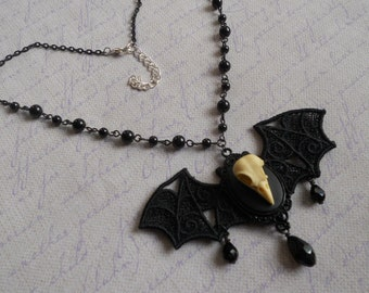 bird skull cameo necklace with lace bat wings and black beads chain goth lolita