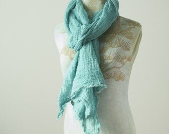 light teal blue hand dyed wavy textural long cotton gauze scarf with raw edges