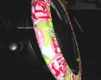 Steering wheel cover with pink roses on light green. Amy Butler floral fabric.