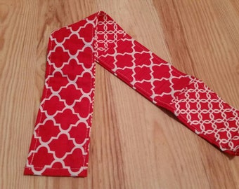 Red and white reversable camera strap slipcover
