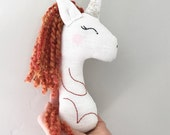 Red haired unicorn baby