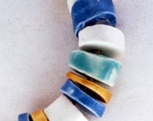 Immensity of the sea -- a set of 11 blue, white and golden small ceramic beads