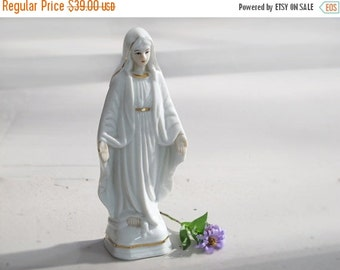 Antique french madonna in  porcelain