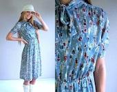 60% Off vintage 80s Sage Green PEOPLE PRINT neck tie Dolly DRESS Small/Medium novelty kitschy secretary indie retro